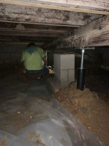 Man Installing Crawl Space Stabilizers
