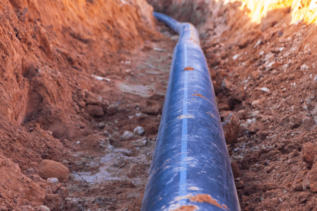 Black water pipe lying in trench